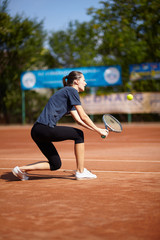 Tennis player executing a backhand volley