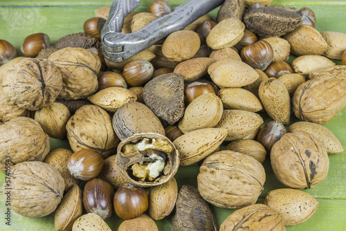 An assortment of nuts on wooden table