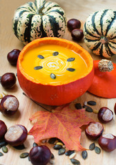 Delicious pumpkin soup with cream and seeds