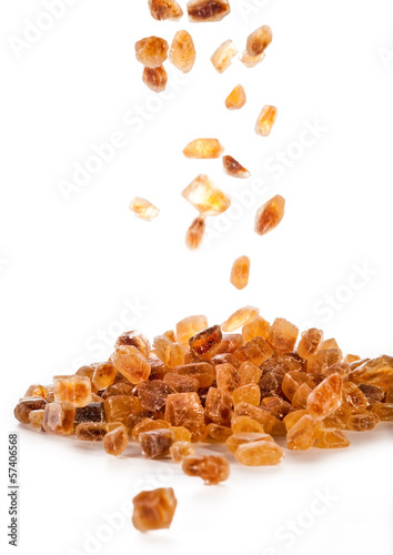 Slices of falling brown candy sugar ..