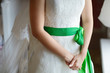 Bride's hands on a wedding dress