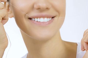 Woman and teeth floss