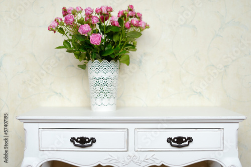 White vase full of pink roses