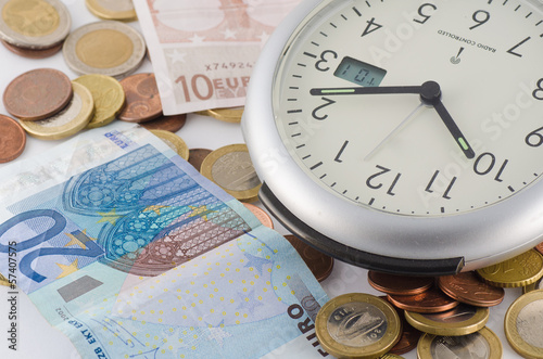 time is money with standing clock and euro's