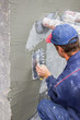 building worker spreading mortar on concrete wall 4