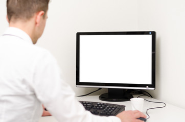 man behind computer with white screen