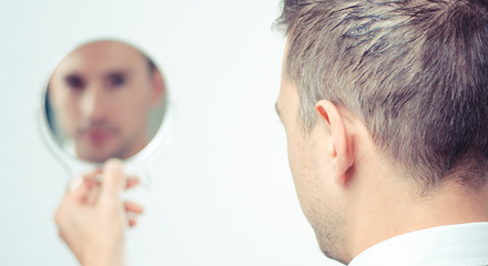 ego man reflection in mirror on a white background