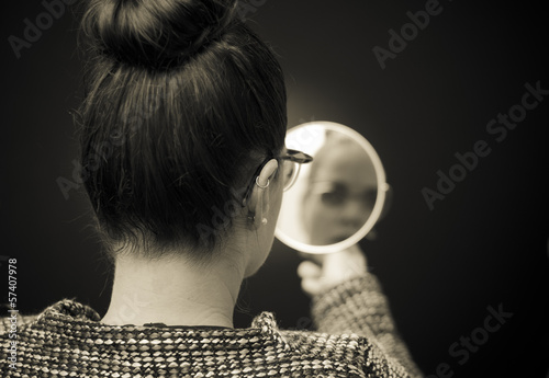 businesswoman looking in the mirror and reflecting Poster
