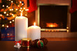 two christmas candles focus on flame shallow DOF