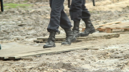 Military forces boots step over dirt, rescue emergency situation