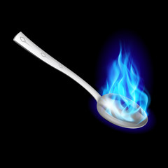 Metal spoon with blue fire.