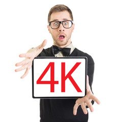 Surprised businessman holding tablet computer that states 4k