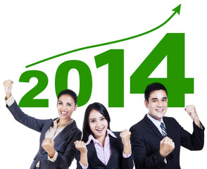 Business team celebrating a new year 2014