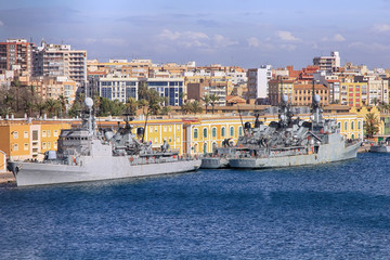 modern warships moored in port