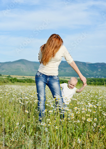 mother and son playing in field