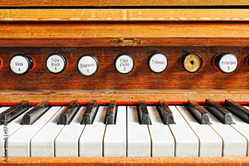 Antique organ keyboard with stops