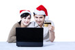 Christmas couple shopping online using credit card