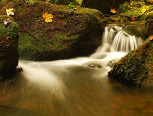 Cascade of small weir on mountain stream