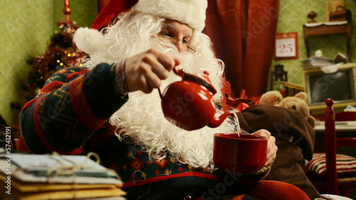 Santa Claus drinking a cup of tea