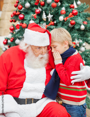 Boy Telling Wish In Santa Claus's Ear