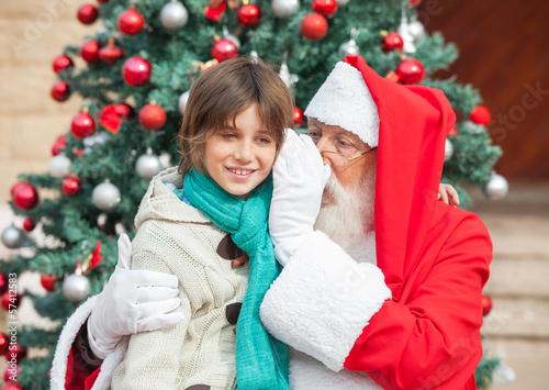 Santa Claus Whispering In Boy's Ear