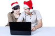 Romantic couple buying christmas gift online