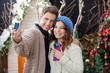 Couple Taking Selfportrait In Christmas Store