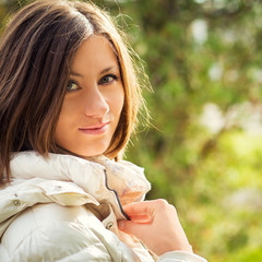 Outdoor fashion stunning closeup portrait of pretty young girl.