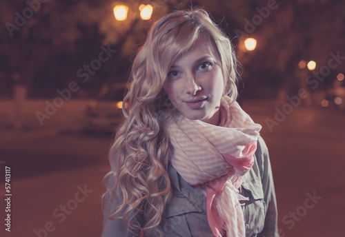 young female businesswoman in night city. Close-up.