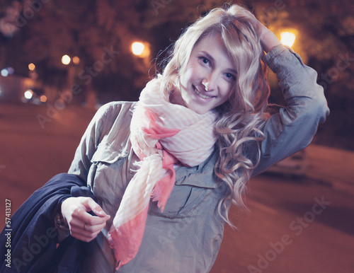 Portrait of a young female businesswoman in night