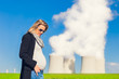 Beautiful Pregnant Women in front of a Nuclear Power Plant