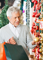 Man Choosing Christmas Ornaments