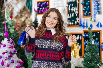 Beautiful Woman Holding Small Shopping Bags In Store