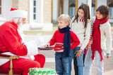 Boy Taking Biscuits From Santa Claus