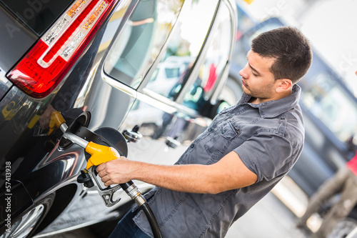 Young Man Filling His Car at Gas Station
