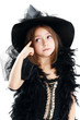 beautiful cute little girl in witch halloween costume hold the b