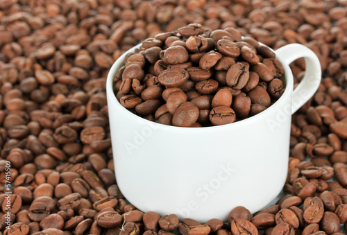 Coffee beans in cup close-up