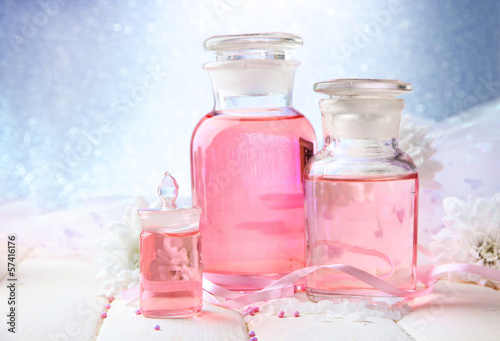Glass bottles with color essence, on blue background