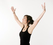 Pretty Brunette Woman Arms Outstretched Jubilant Looking Up