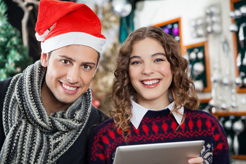 Couple With Digital Tablet At Christmas Tore