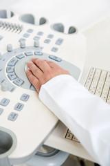 Gynecologist's Hand Using Ultrasound Machine