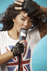 Singing Woman with Retro Microphone. Beauty Glamour Singer Girl.