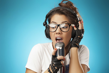 Singing Hipster with Retro Microphone. Beauty Glamour Singer Gir