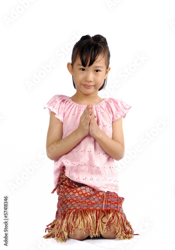 asian small child pay respect in Thai costume style