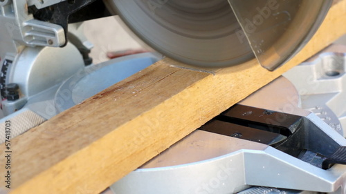 Industrial Miter Saw Cutting Wood