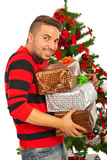 Happy funny man with stack of presents