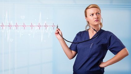 Pretty medical doktor listening to red pulse and heart rates