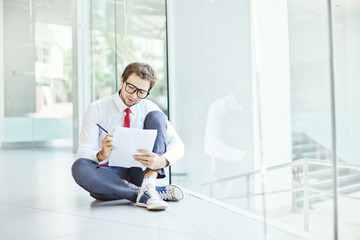 businessman or student sitting on a floor