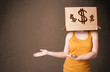 Young girl gesturing with a cardboard box on his head with dolla