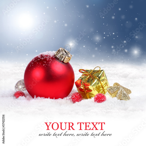 Christmas background with red ornament and snowflakes